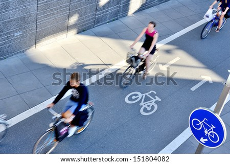 Bicyclists in bike lane seen from above