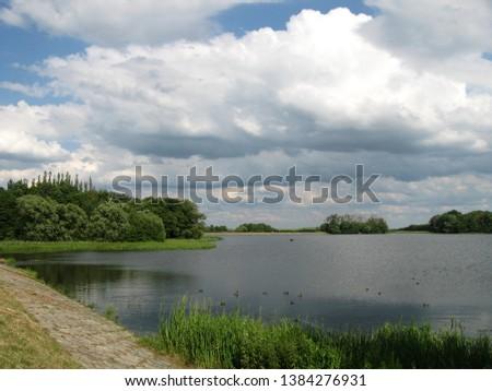 Bielkowski Zbiornik Wodny, reservoir in Kolbudy, Pomorskie, Poland on a cloudy summer day Zdjęcia stock ©