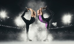 Biellmann spin. Couple figure skating in action. Sports banner. Horizontal copy space background