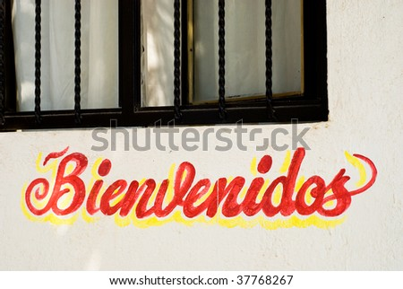 Bienvenidos welcome sign on restaurant wall in Mexico