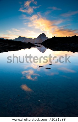 Bietschorn mountain peak at sunrise reflecting in small lake, Loetschenpass, Wallis, Switzerland