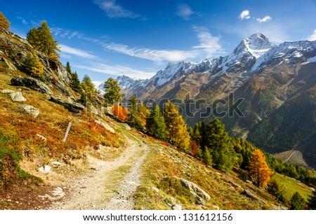 Bietschorn mountain peak in autumn with hiking trail. View from Laucheralp, Loetschental, Wallis, Switzerland