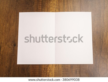 Bifold white template paper on wood texture #380699038