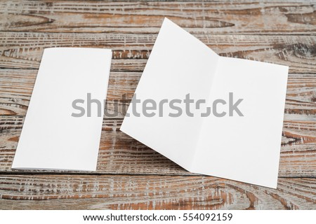 Bifold white template paper on wood texture #554092159