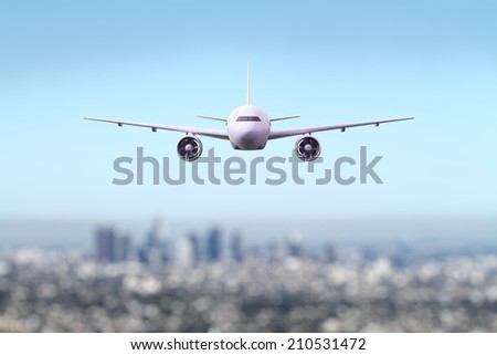 big airliner flying over the city - Shutterstock ID 210531472
