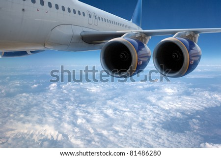 Big airliner in the blue sky with clouds. - stock photo