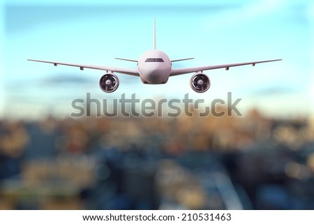 big airplane flying over the city - Shutterstock ID 210531463