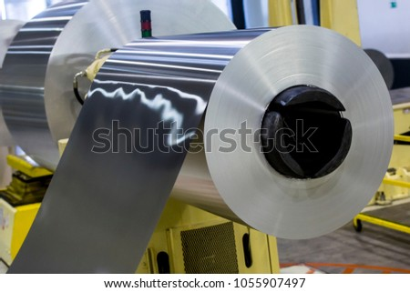 Big aluminum coils. Modern machine for Aluminum line production, Business and Industrial concept
