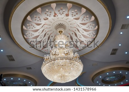 Big and old expensive crystal chandelier .illustration of a chandelier with crystal pendants on the black . Palace ball hall for dancing, ballroom.