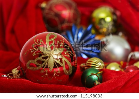 Big and small Christmas tree decorations on a red background