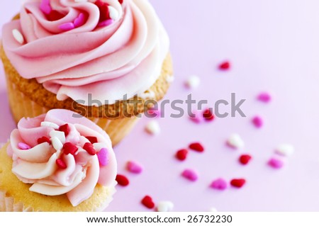 Big and small cupcakes with icing and sprinkles