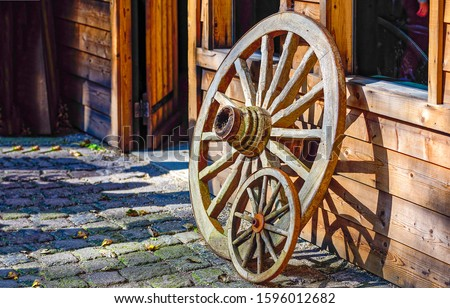 Photo of  Big and small wagon wheels. Wooden wagon wheels. Wagon wheels. Farm wagon wheels