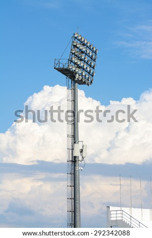 Big and tall stadium spot light under blue sky white cloud #292342088