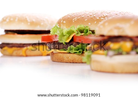Big and tasty burgers over white background