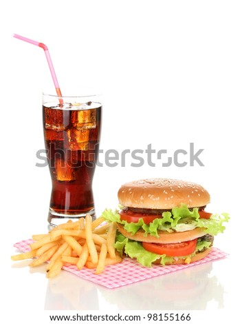 Big and tasty hamburger and fried potatoes with cola isolated on white