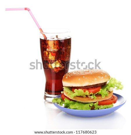 Big and tasty hamburger on plate with cola isolated on white