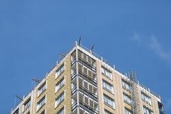 Big apartment buildings under construction. Building under construction against blue sky. High quality photo