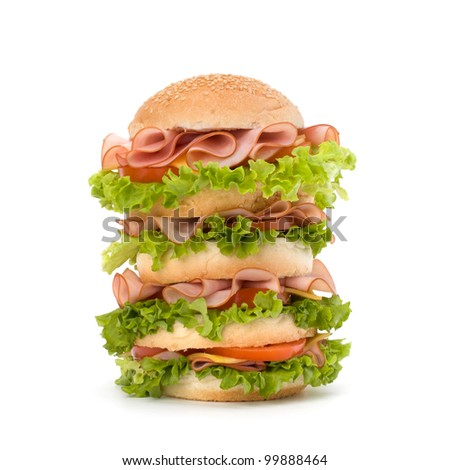 Big appetizing fast food sandwich with lettuce, tomato, smoked ham and cheese isolated on white background. Junk food hamburger.