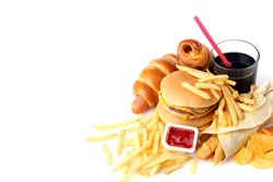 Big appetizing hamburger with fries and a coke and chips on a white isolated background