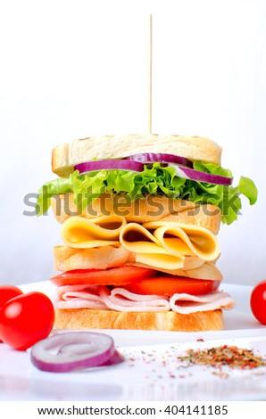 Big appetizing sandwich. Meat sandwich.Great sandwich.Sandwich on a white background.