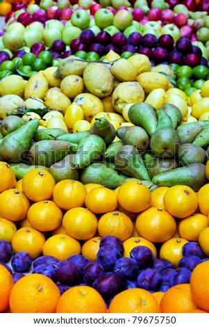 Big assortment of fresh organically grown fruits - stock photo