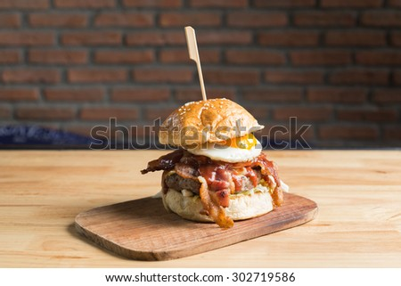 Big bacon and beef steak burger with fried egg