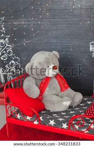 big bear on the red child's bed