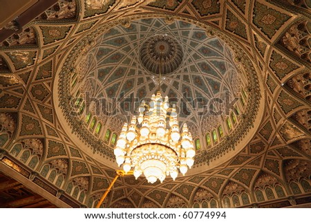 big beautiful lustre in a hall of Grand Mosque in Oman. the lights is on.