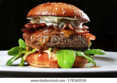 big beef burger full of fresh vegetable