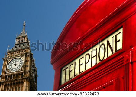big ben and classic red telephone cabin on clean blue sky background