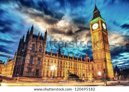 Big Ben and House of Parliament at dusk with clouds from Westminster Bridge - London - UK