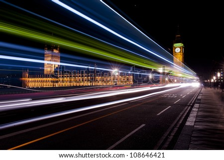 big ben and house of parliament seen through the traffic lights