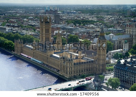 Big Ben and the Palace of Westminster, London. Aerial view including Westminster Abbey and Battersea Power-station.
