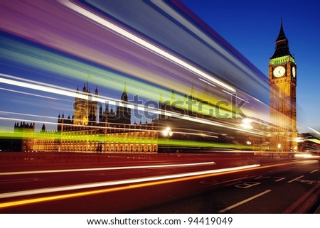 Big Ben behind light beams at twilight time, London - stock photo