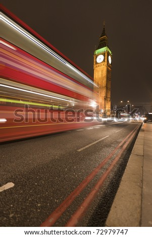 Big Ben behind light beams at twilight time, London, UK