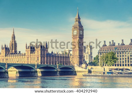 big ben clock tower and house...