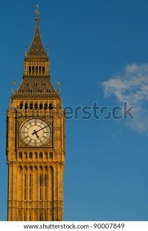 Big Ben in London against the blue sky in portrait format