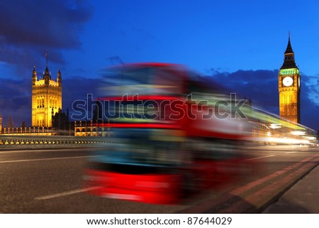 Big Ben in the evening with red bus in London, Uk