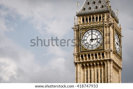Big Ben, London, UK. A view of the popular London landmark, the clock tower known as Big Ben, showing 3pm as the time set against a blue and cloudy sky. #418747933