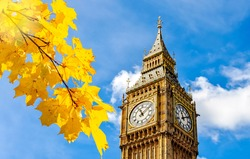 Big Ben tower of Houses of Parliament in autumn, London, UK