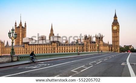 Big Ben, Westminster Bridge and the Houses of Parliament, London. Low angle view of the key London landmark Big Ben in the early morning sun. #552205702