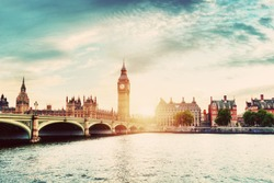 Big Ben, Westminster Bridge on River Thames in London, the UK. English symbol. Sunset sky with some clouds. Vintage