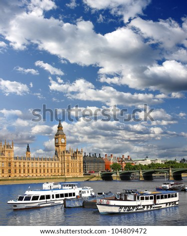 Big Ben with boat and bridge in London, UK