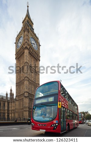 Big Ben with red double-decker in London, UK. Cityscape shot with tilt-shift lens, the vertical lines of the object stored