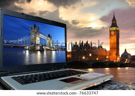 Big Ben with Tower Bridge on screen of notebook, London, UK