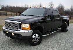 Big black dual rear tire diesel truck.