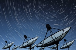 Big black Satellite Dish on star trail sky background