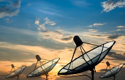 Big black Satellite Dish on sunset background