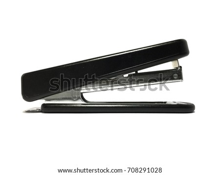Big black stapler is isolated on a white background.