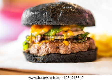 Big Black Tasty Sandwich - Hamburger Or American Burger With Beef, Pickles, Tomato And Sauce On Table. Concept Fast And Unhealthy Food, Unhealthy Eating. #1234713340